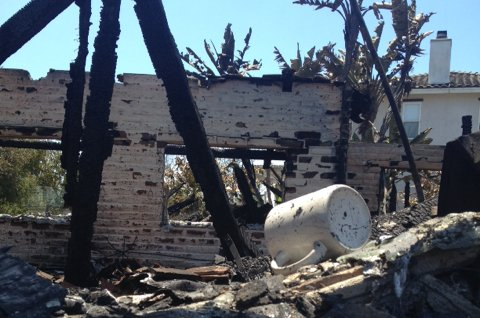 Little is left of Gregory Saksa's Carlsbad home, which burned in the Poinsett...