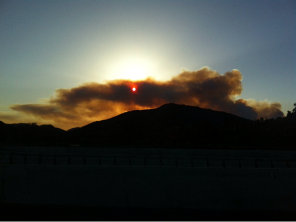 The sun is shown through thick smoke along Interstate 15 near Rancho Bernardo, May 14, 2014.