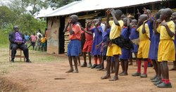 Bishop Christopher Senyonjo visiting a rural school in Uganda.