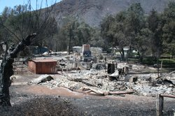 Most of the homes and structures at the Harmony Grove Spiritualist retreat center were destroyed in the Cocos fire, May 16, 2014.
