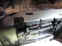 The heroin was hidden inside a non-factory compartment beneath the back seat,...