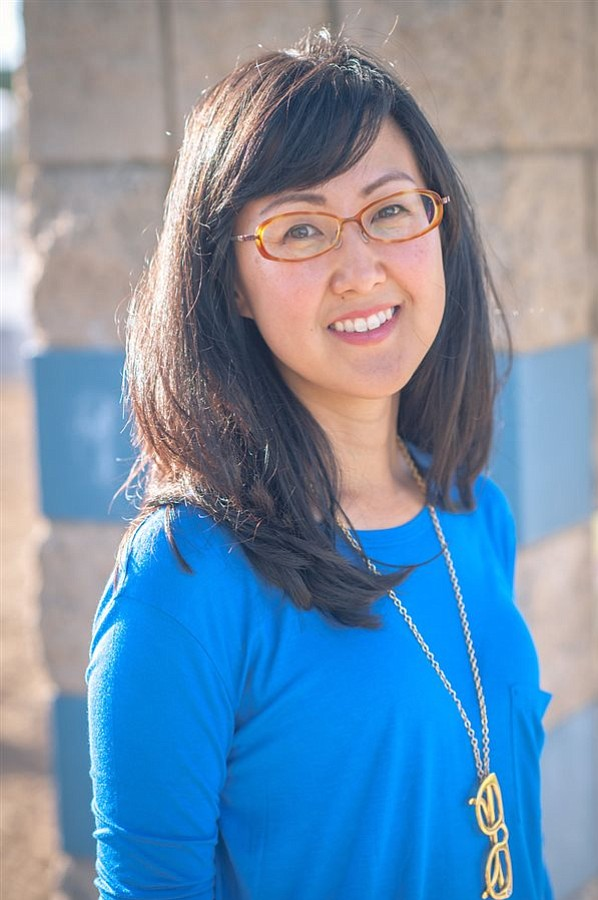 A portrait of Carol Kim.