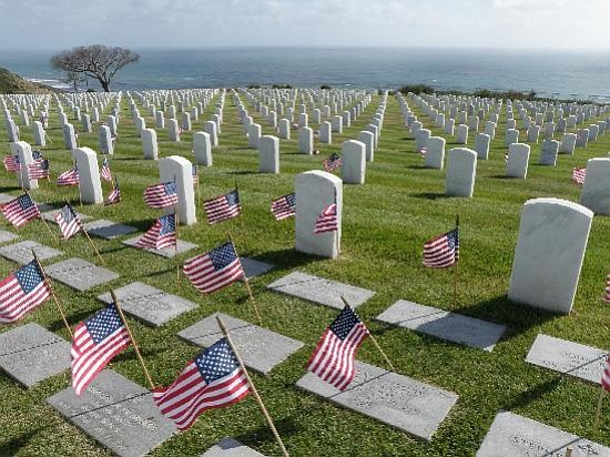 Small flags are placed at each grave site in honor of Mem...