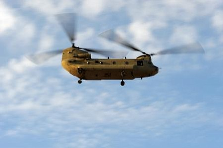 A U.S. Army CH-47 Chinook departs from Kandahar Airfield, Afghanistan, Dec. 2...