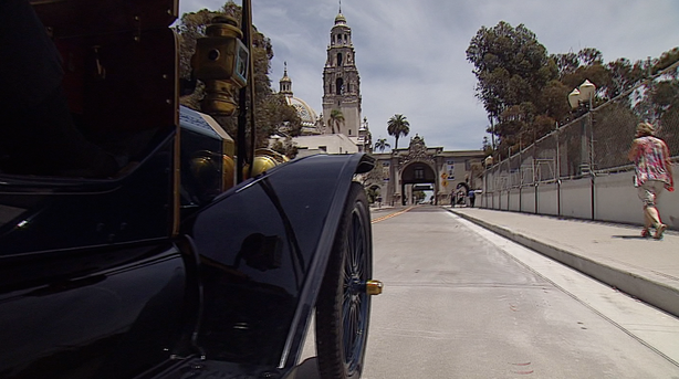 Vintage automobiles cross the Cabrillo Bridge in Balboa Park after it was reopened after five months of maintenance.