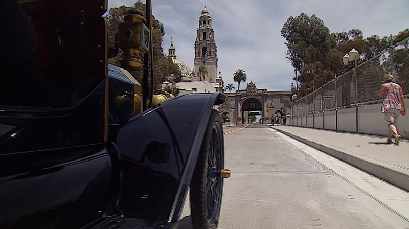 Vintage automobiles cross the Cabrillo Bridge in Balboa Park after it was reo...