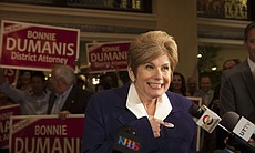 "District Attorney Bonnie Dumanis points to her ""I Voted"" sticker at the U.S. ..."