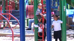 Children climb and enjoy a playground in South County San Diego, June 3, 2014.