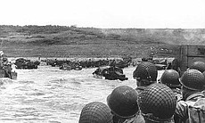 Soldiers crowd a landing craft on their way to Normandy during the Allied Inv...