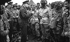 Supreme Allied Commander U.S. Army Gen. Dwight D. Eisenhower speaks with 101st Airborne Division paratroopers before they board airplanes and gliders to take part in a parachute assault into Normandy as part of the Allied Invasion of Europe, D-Day, June 6, 1944.