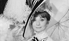 "Audrey Hepburn, in extravagant frills and hat, as Eliza Doolittle in ""My Fair Lady,"" directed by George Cukor. (Agency reference 3168803)"