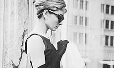 "Audrey Hepburn stops for lunch on Fifth Avenue in New York during location filming for ""Breakfast At Tiffany's,"" directed by Blake Edwards in which she stars as Holly Golightly. (Agency reference 3171980)"