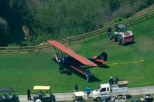 Vintage Biplane Lands At Torrey Pines Golf Course