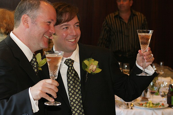 Gleason, and his husband, Marc, toast to their marriage a...