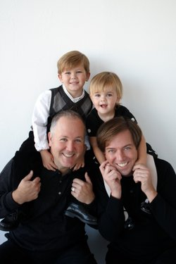 2014 LGBT Pride Month Local Hero, Robert Gleason with spouse Marc, and their two children.