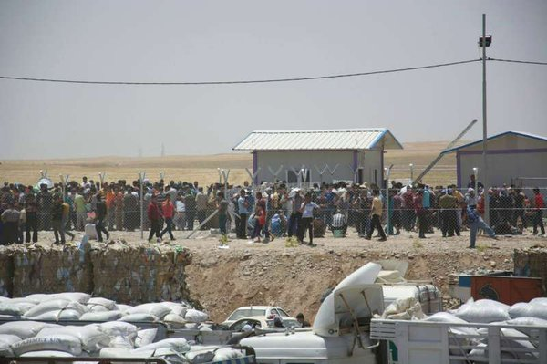 Iraqis fleeing violence in Mosul arrive in the Kurdistan ...