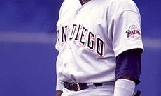 Tony Gwynn smiles after reaching base on a hit.