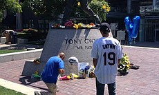 Tony Gwynn fans pay tribute to the baseball legend in front of his statue at Petco Park, June 16, 2014.