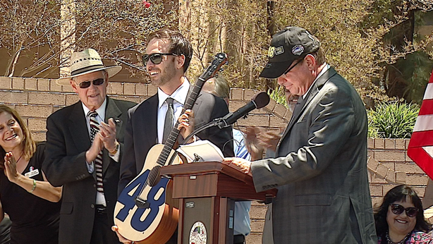 Jimmie Johnson accepts his personalized guitar at a ceremony in El Cajon, Jun...