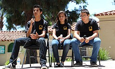 Alwaled, 19, Lina, 16, and Andrew, 14, discuss their work in Peacemakers, a youth program run by the International Rescue Committee, during the World Refugee Day event on June 21, 2014 in Balboa Park.