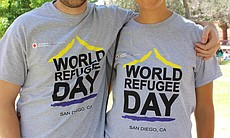 Volunteers Javier Herraez-Galvan and Monica Perez-Santiago, who are members of the Red Cross AmeriCorps National Preparedness and Response Corps, provided information and assistance to World Refugee Day event attendees June 21, 2014.