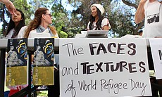 "The Museum of Photographic Arts in Balboa Park hosted ""The Faces and Textures of World Refugee Day"" booth to encourage World Refugee Day participants to take self portraits."