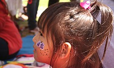 A 4-year-old Karen child takes in the World Refugee Day festivities at Balboa Park June 21, 2014.