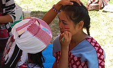 May Aye, a member of the Karen community in San Diego, has her face painted before performing a traditional Karen dance at the annual World Refugee Day event in Balboa Park on June 21, 2014.