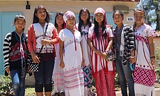 Karen youth came together in Balboa Park June 21, 2014 to celebrate their culture through face panting, traditional dress and dance at the annual World Refugee Day event.