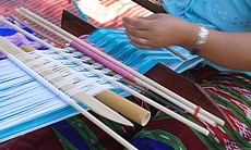 A member of the Karen community demonstrates weaving techniques during the World Refugee Day event on June 21, 2014. Local Karen refugees meet regularly to weave in an effort to socialize and keep the tradition alive.