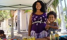 During the annual World Refugee Day event in Balboa Park June 21, 2014, Roxana and her daughter sell homemade shea butter cream and celebrate their indigenous African and El Salvadoran roots.