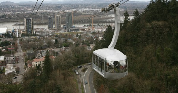 An aerial tram in Portland, Oregon carries commuters between the city's South Waterfront district and the main Oregon Health & Science University (OHSU) campus.