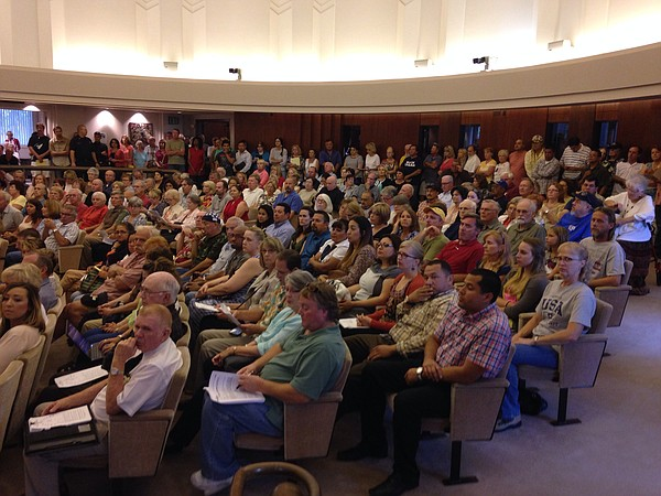 People packed the Escondido City Council chambers at a he...