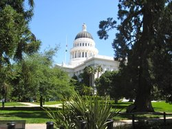 Flags lowered to half-staff above the State Capitol in Sacramento.