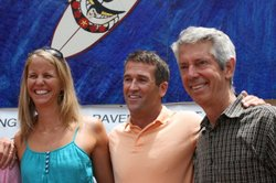Mark Patterson, mosaic creator and chairman of Surfing Madonna Oceans Project (second from left) along with Megan McCarthy, project marketing assistant, and Bob Nichols, project vice chairman, celebrate the new home of the Surfing Madonna mosaic in Encinitas, July 29, 2014.