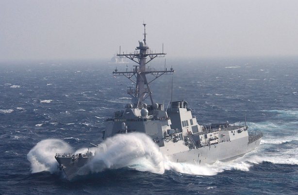 Guided missile destroyer USS Howard prepares for a scheduled replenishment at...