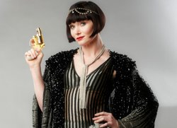 The Honorable Miss Phryne Fisher (Essie Davis) with her gun.