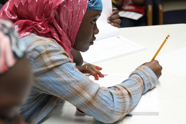 A San Diego Unified student participates in an after-school tutoring program through the Somali Bantu Association of America in 2014.