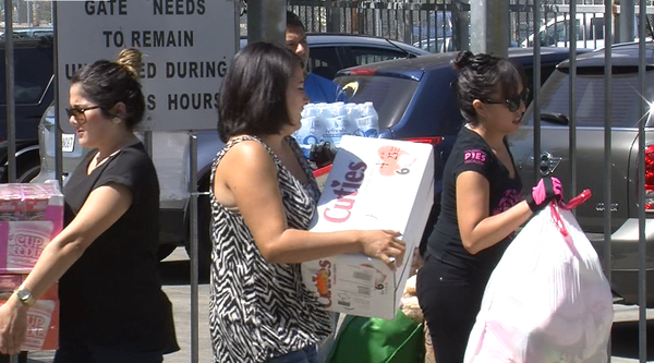 People carry in donations to the Border Angels office near downtown San Diego...