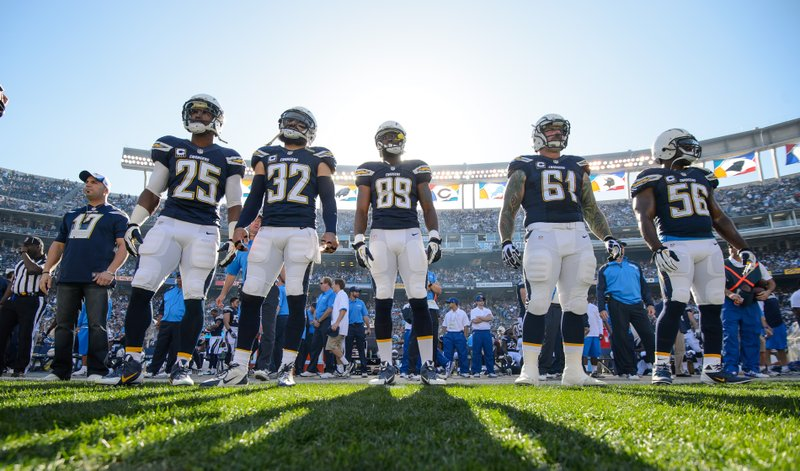 The San Diego Chargers team captains get ready for the pregame coin toss, Dec...