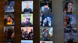 Photos line a wall at Camp Widow, a three-day workshop in San Diego for people who have lost a loved one, July 11, 2014.