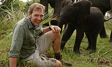 Veterinarian Mark Evans and a baby elephant.