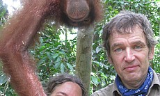 Anatomist Joy Reidenberg and veterinarian Mark Evans hanging around with an orangutan.