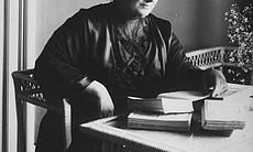 Maria Montessori at a desk working, 1913. (41345)