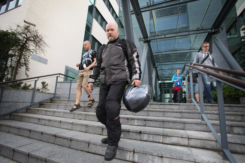 Workers leave software company Microsoft's office, in Oulu, Finland, July 17,...