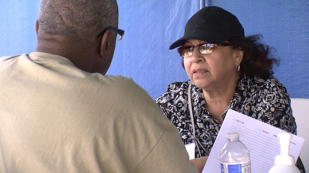 A veteran checks in at the counseling booth at the 27th annual Stand Down event July 18, 2014 to learn about the housing and health services he can access.