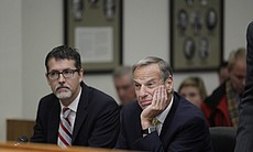 Former San Diego Mayor Bob Filner, right, sits ... (41534)