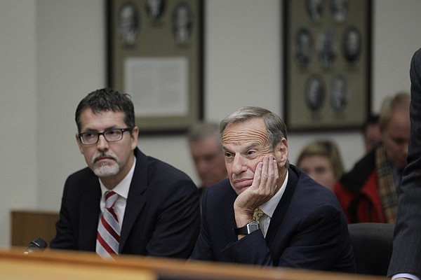 Former San Diego Mayor Bob Filner, right, sits with his l...