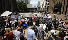 Supporters of San Diego Mayor Bob Filner hold up signs during a rally at the San Diego Concourse on Monday, Aug. 19, 2013, in San Diego.