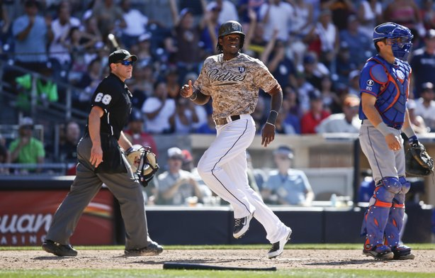 San Diego Padres' Cameron Maybin scores the winning run in the ninth inning of a 2-1 win against the New York Mets, July 20, 2014.